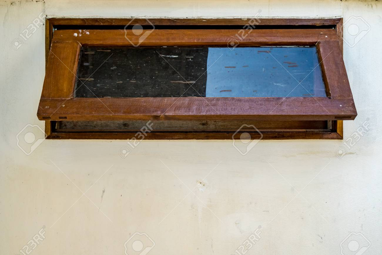 Wooden Awning Windows On Concrete Wall Stock Photo Picture And