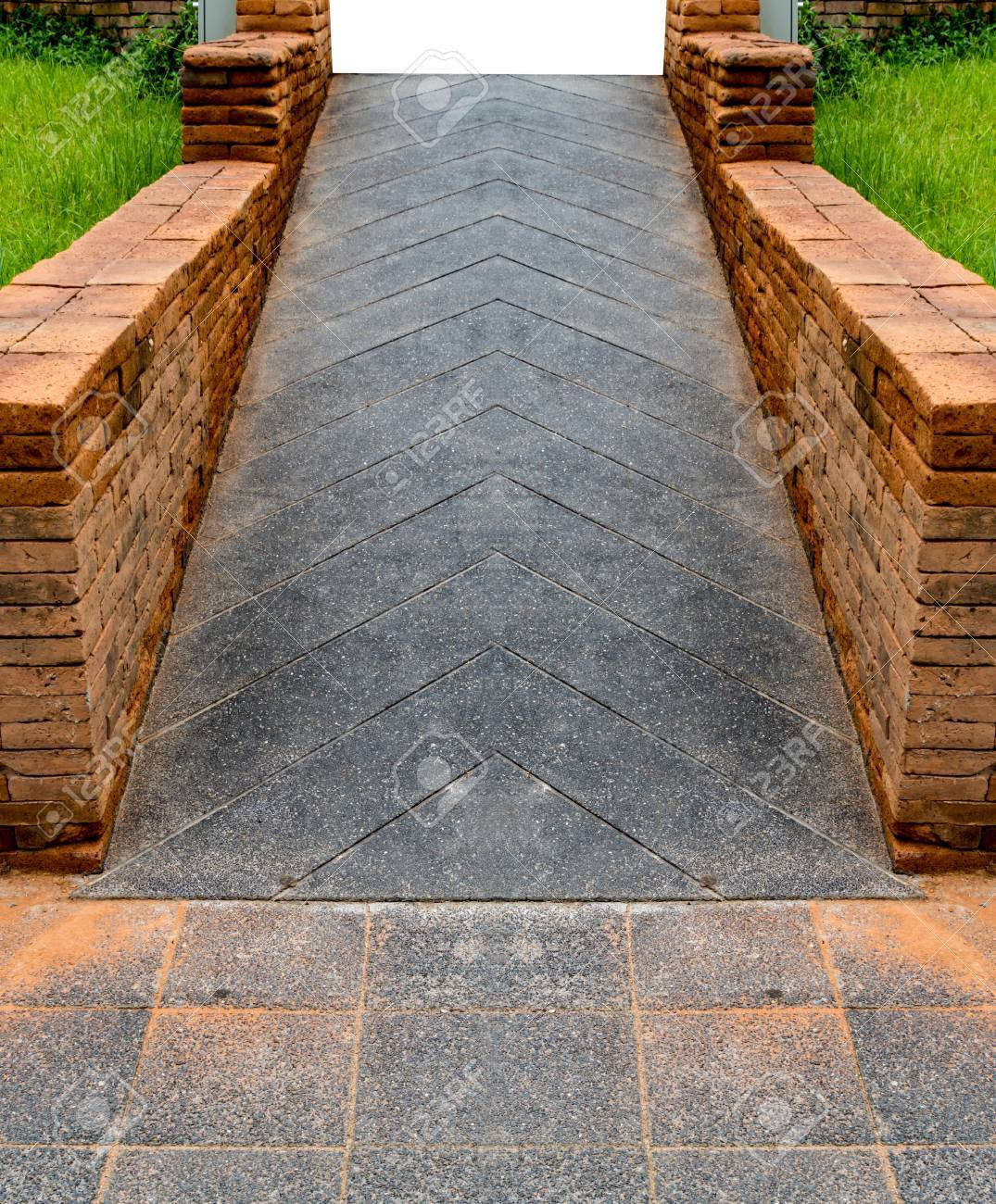 Concrete Ramp For Wheelchair With Brick Railing