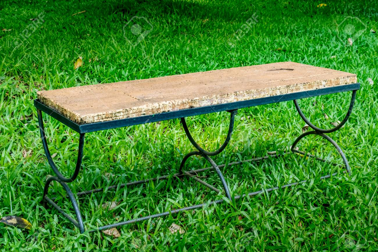 Metal Park Bench On Green Grass In The Park Stock Photo Picture And