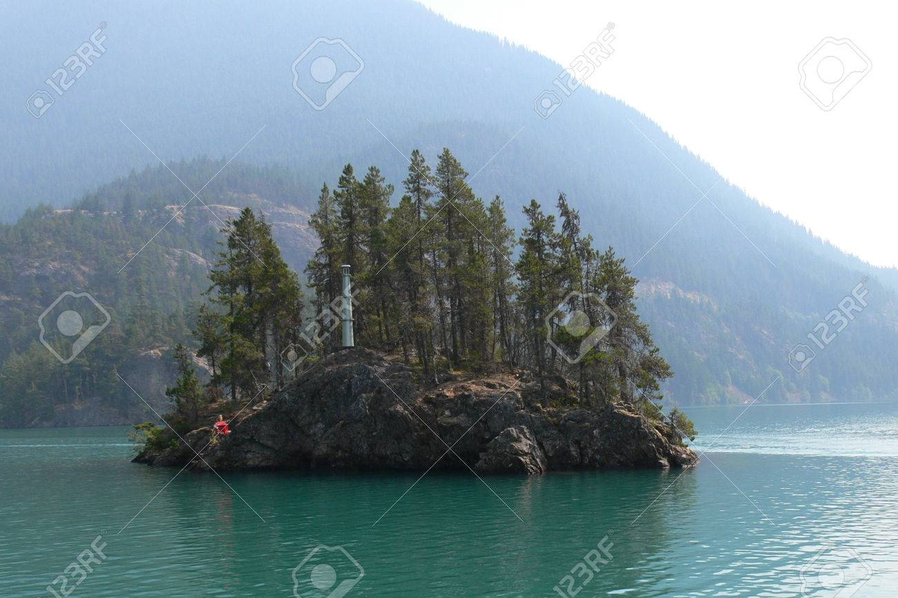 olated Island with a little Light House within Diablo Lake in Washington Stock Photo - 1477135