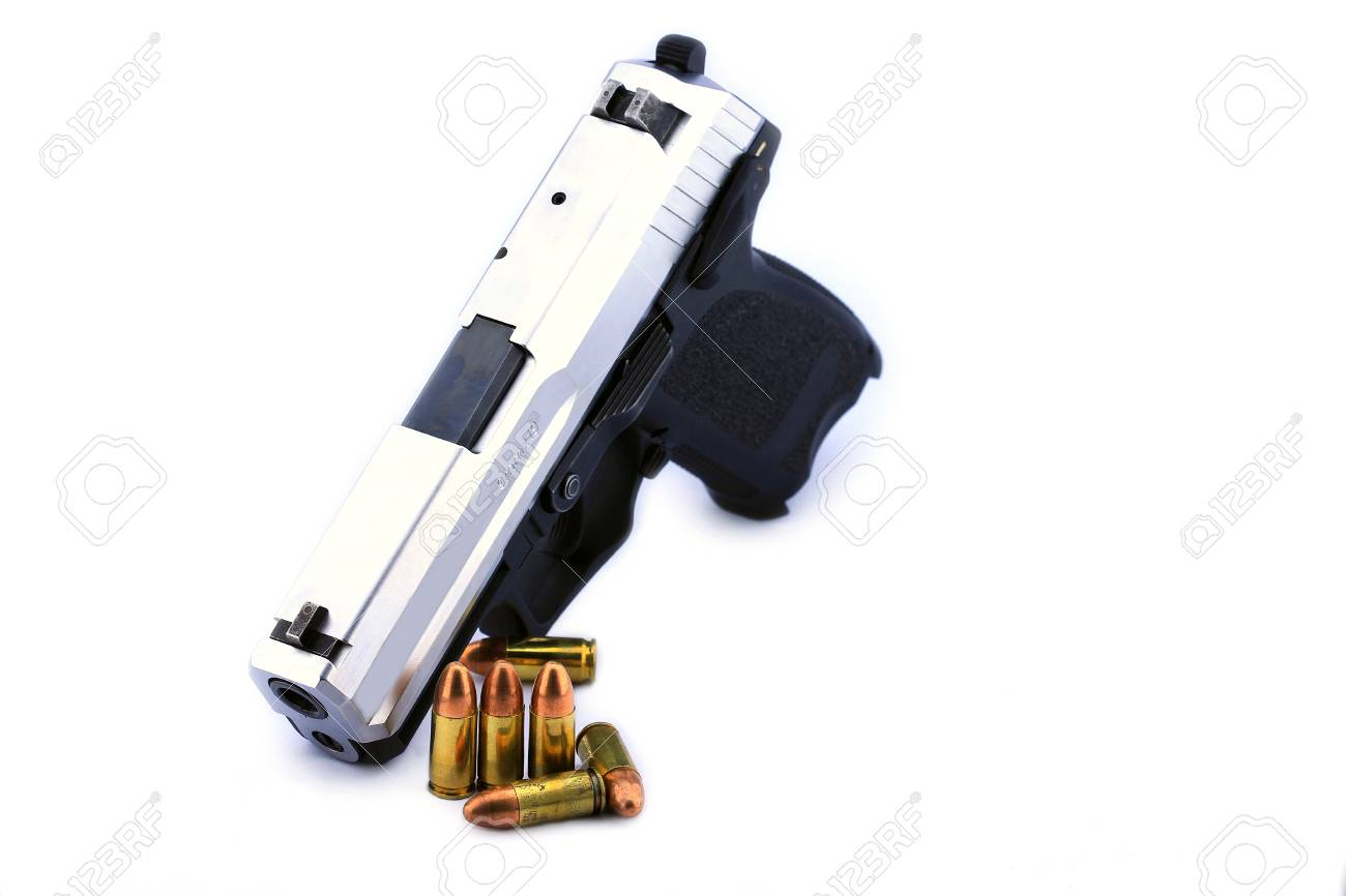 Handgun and bullets on white background Stock Photo - 14732854
