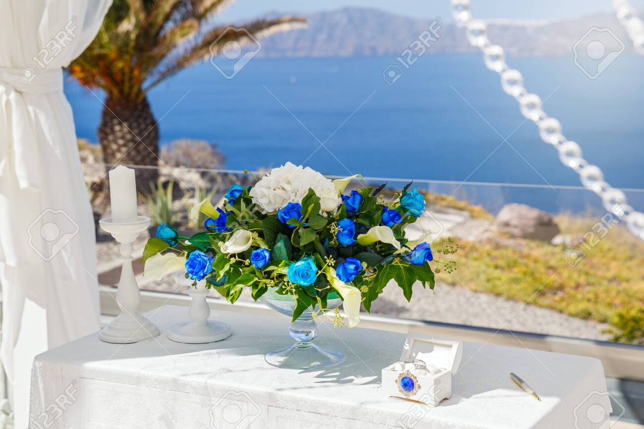 Wedding Decorations And Bouquet With Blue Flowers On The Background