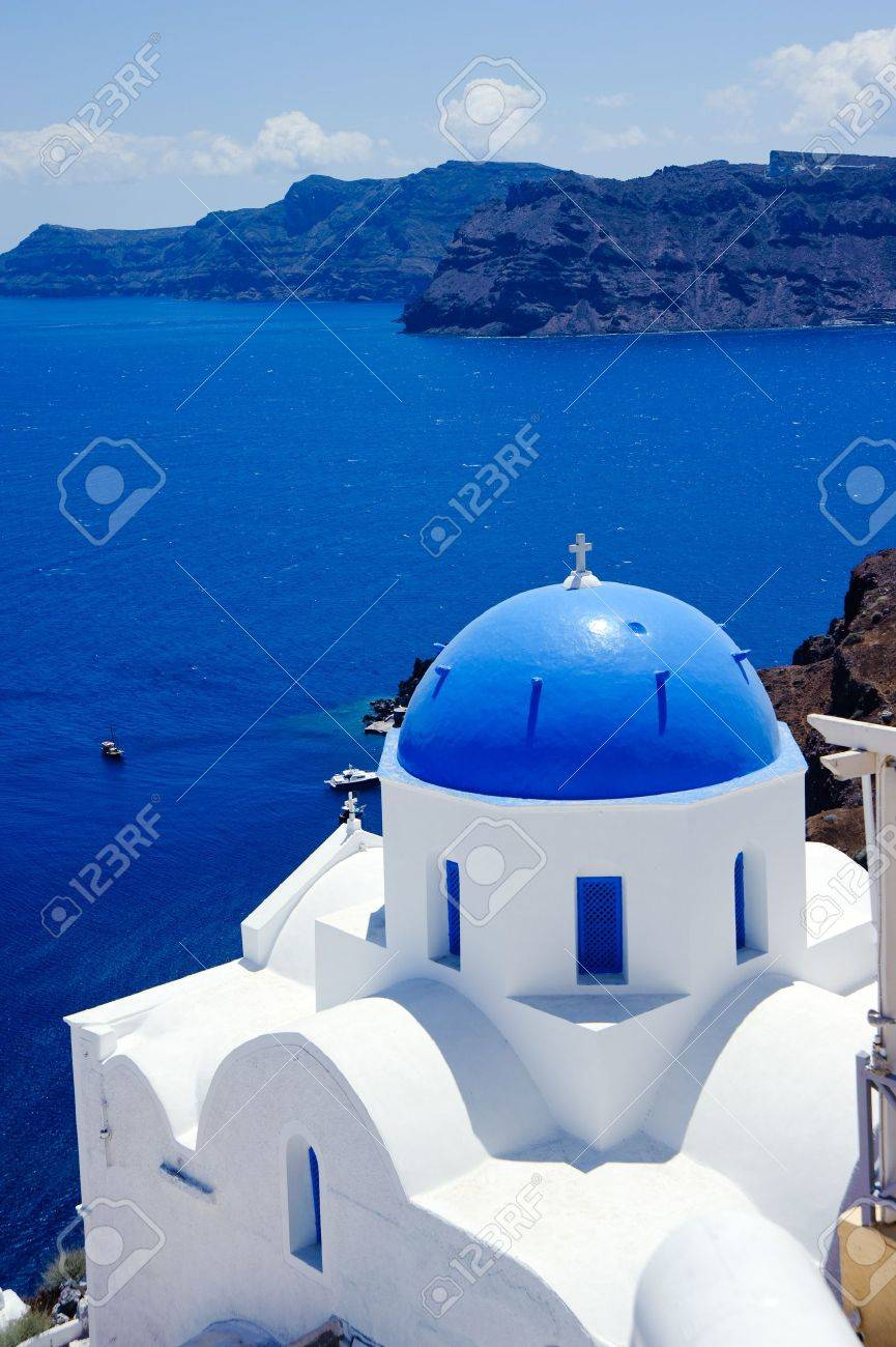 blue dome churches and classic cyclades architecture over the mediterranean sea in oia santorini island,greek Stock Photo - 9044656