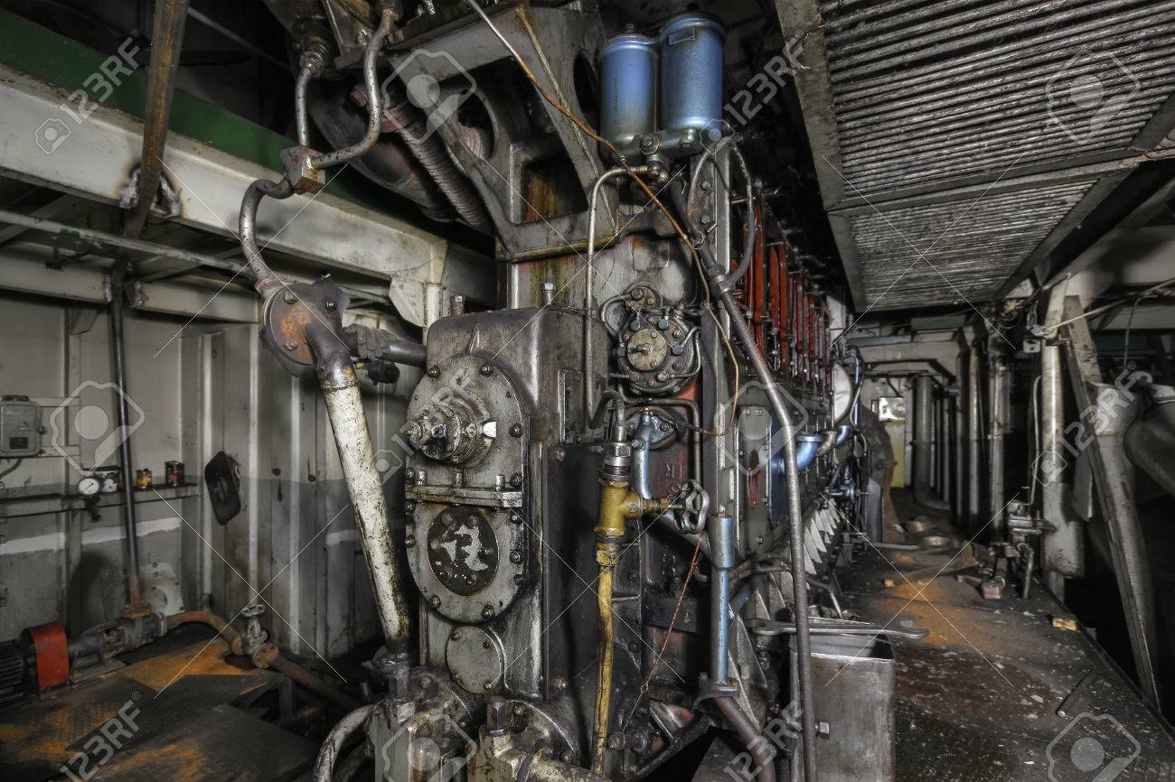 Ship hold with diesel engine mounted on ship  Engine room on
