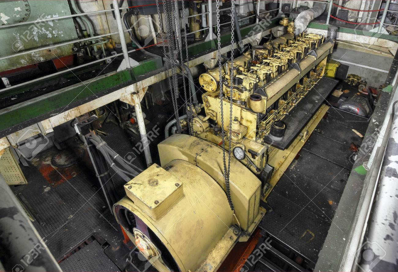 The ship's hold with yellow diesel engine mounted on ship  Engine