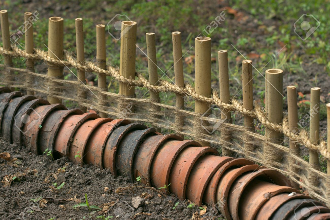 Garden Fence Of Bamboo And Earthen Pots Stock Photo Picture And