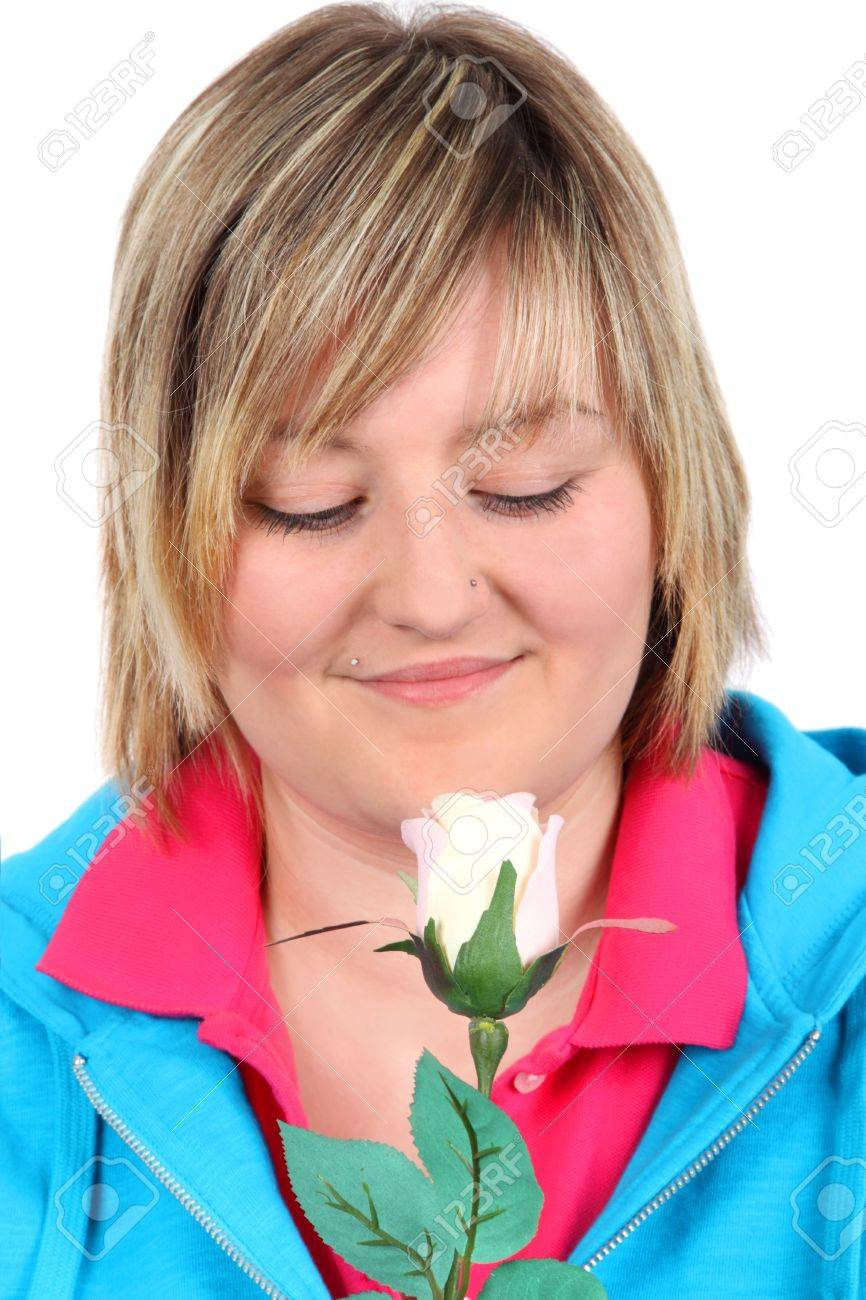 Young woman looking at a white rose - isolated on white background Stock Photo - 6702501