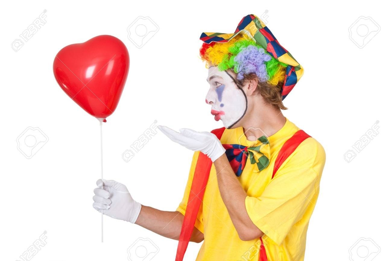Young man with red heartshaped balloon - isolated Stock Photo - 14826555
