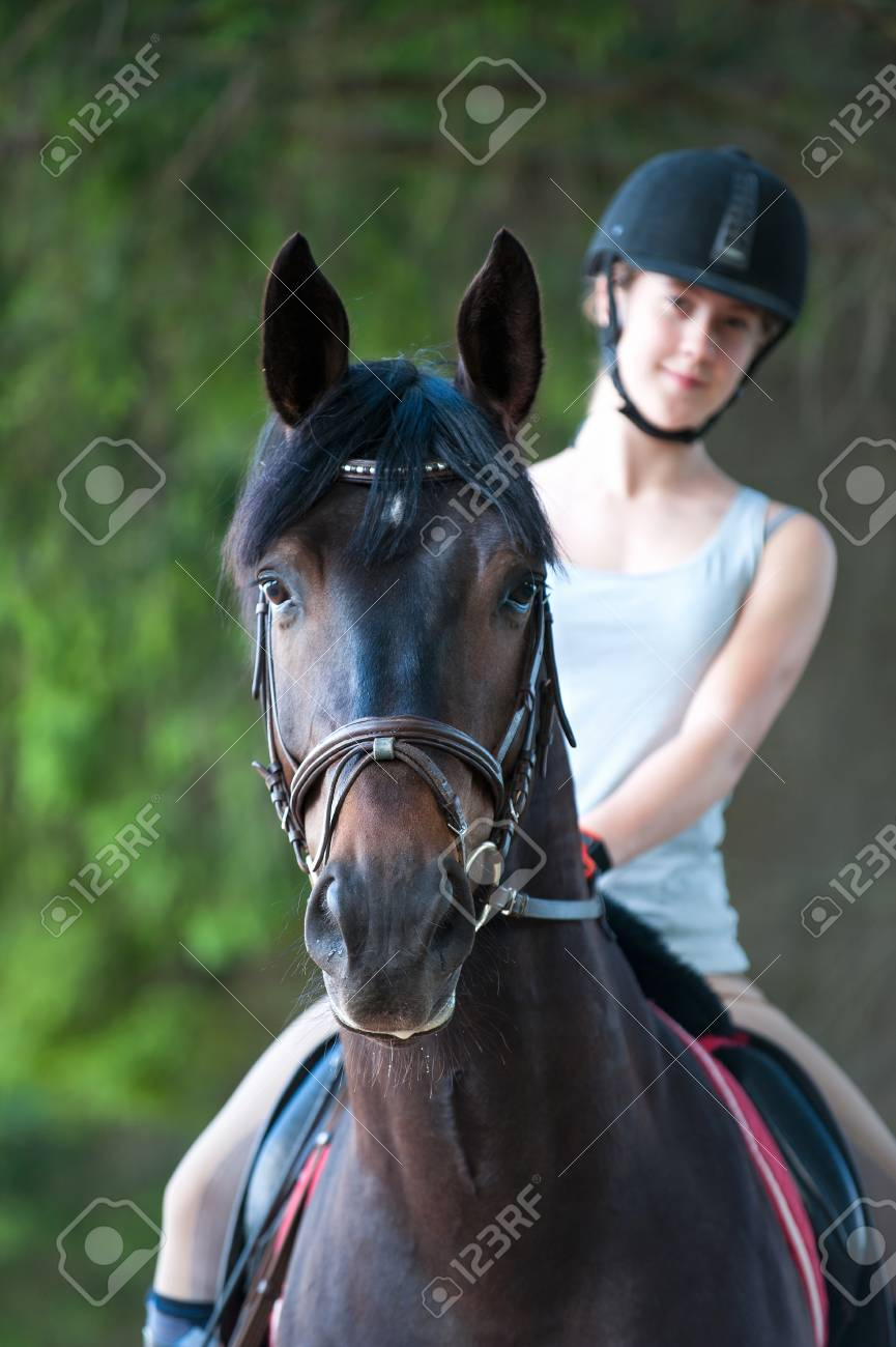 Portrait Of Beautiful Black Horse With Young Pretty Teenage Lady Stock Photo Picture And Royalty Free Image Image 88929476