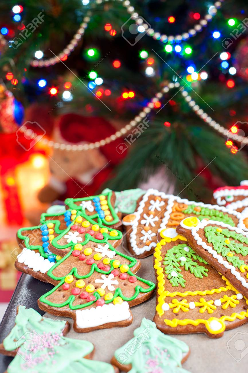 Homemade Christmas Tree Shape Gingerbread Cookies On Oven Mitten
