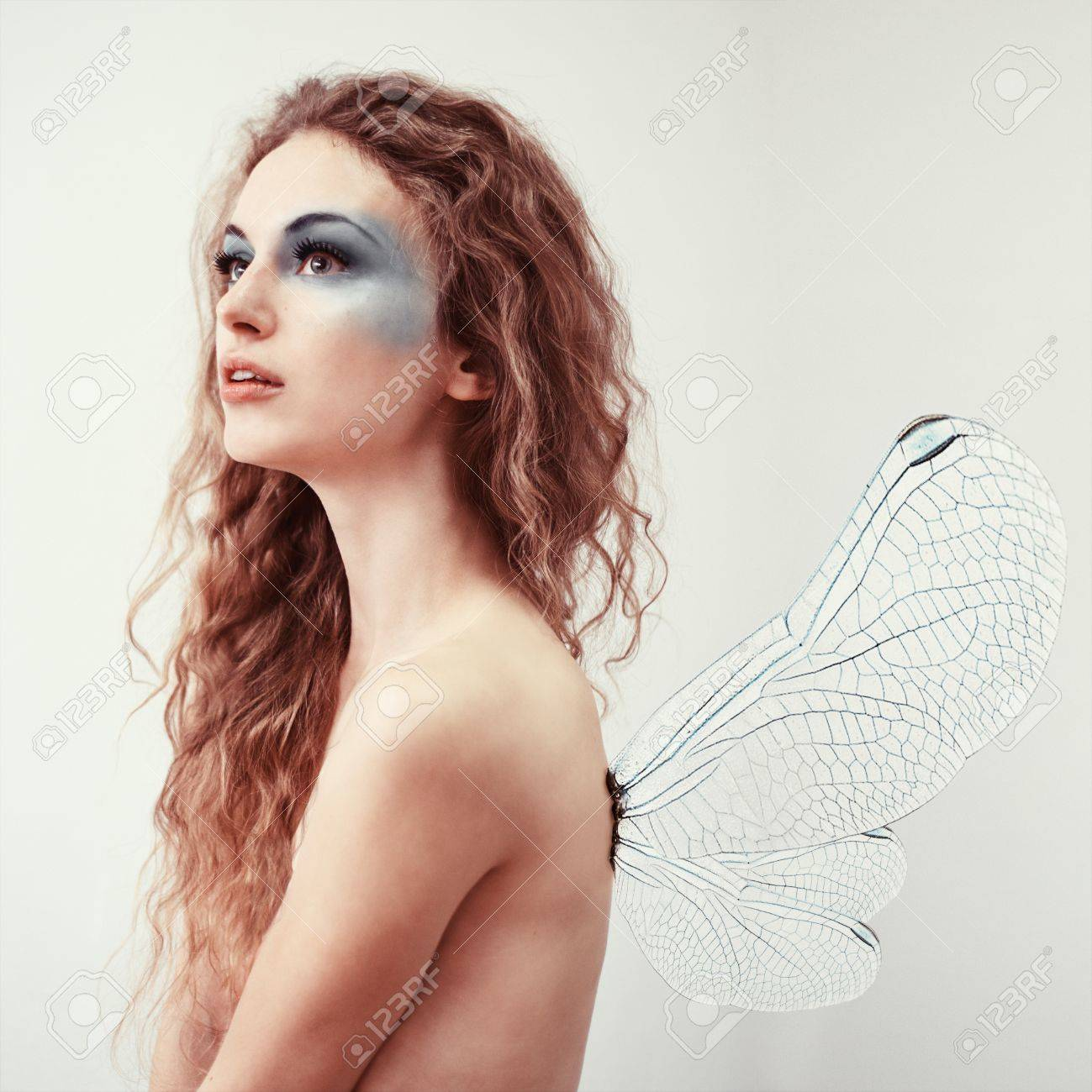 Nude Girl Elf With Make Up Shot In The Studio On A White Background Stock
