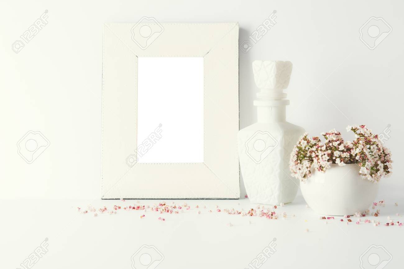 Empty Picture Frame Decorated With Small Pink Flowers And Vintage