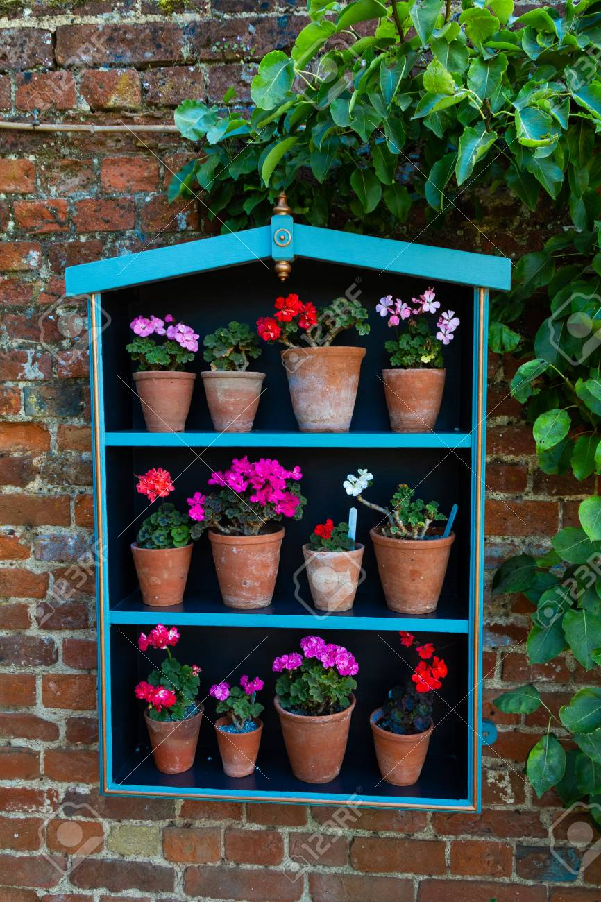 Adorable Planter Box Hanging On A Brick Wall With Brightly Colored