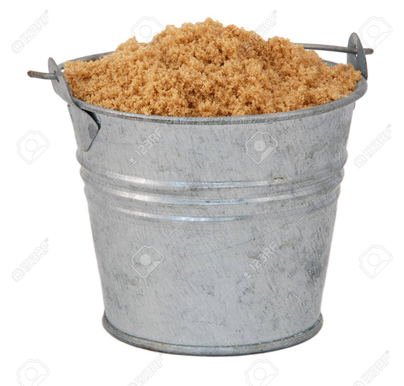 Light Brown Soft Muscovado Sugar In A Miniature Metal Bucket, Isolated On A  White Background