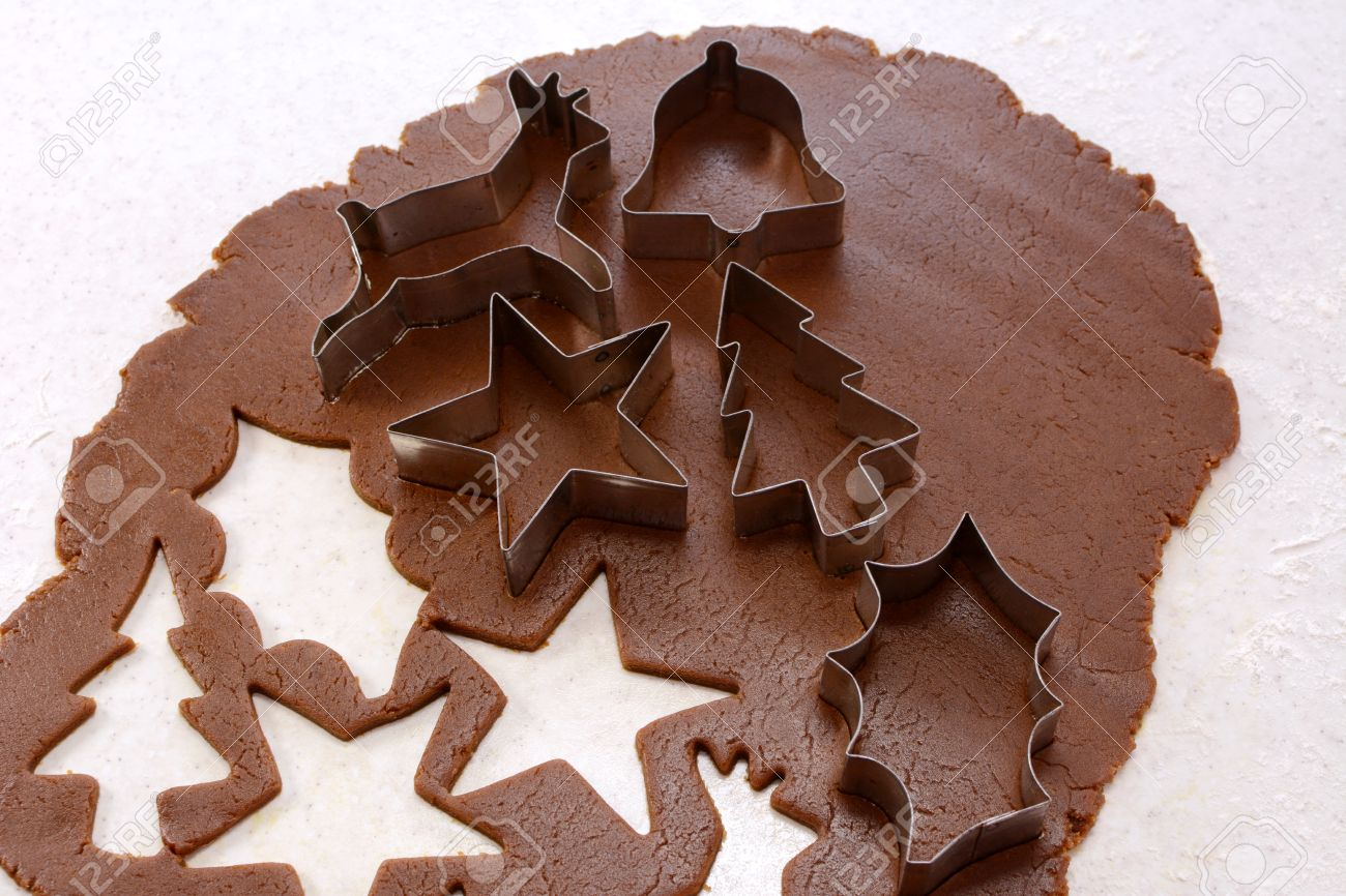 cookie cutters and cut out shapes on gingerbread dough star