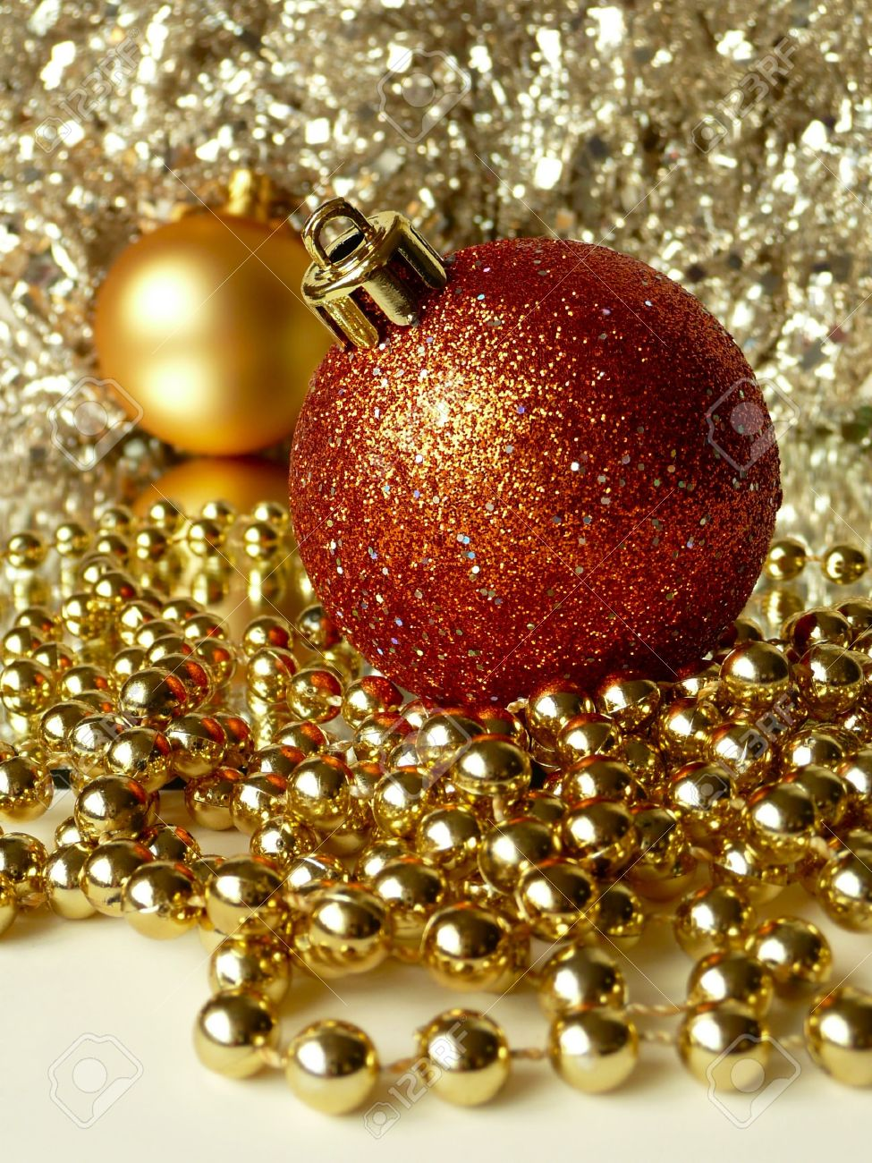 Red & Gold Christmas Tree Balls Surrounded By Tinsel And Decorative Beads  Stock Photo  3574038