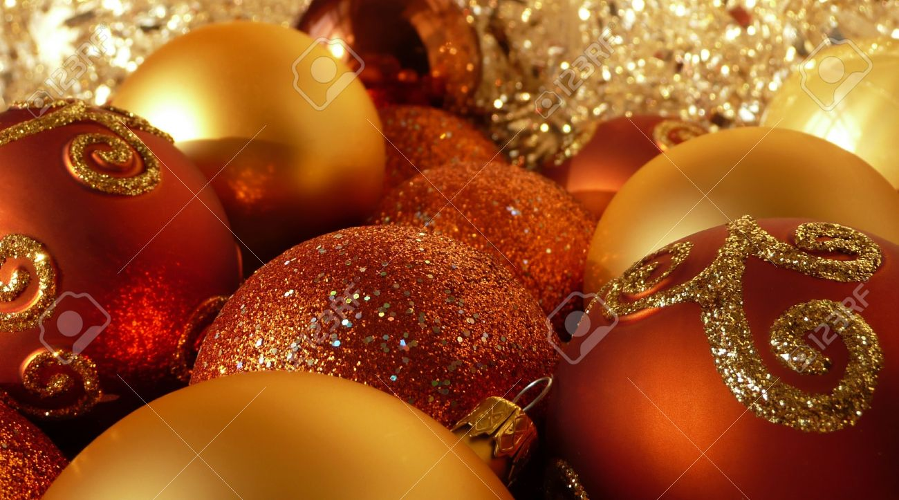 Red Orange And Gold Christmas Tree Balls In Tinsel Stock Photo