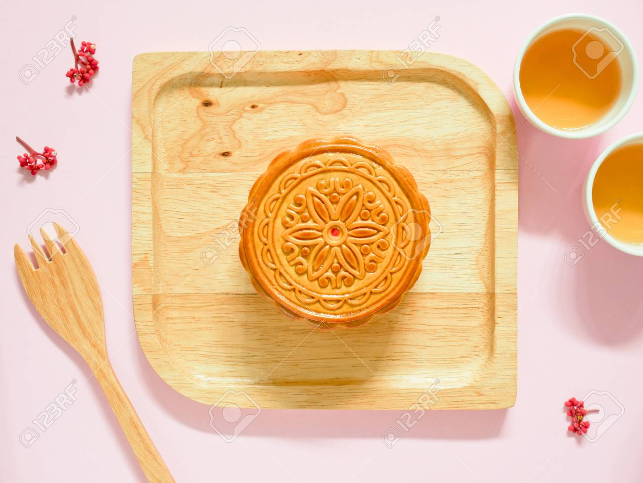 Mooncake on a wooden plate for Mid-Autumn Festival or Mooncake Festival. Top view. - 86895931