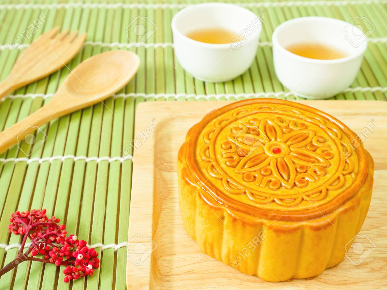 Mooncake on a wooden plate for Mid-Autumn Festival or Mooncake