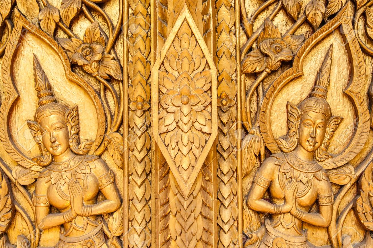 Ancient art pattern on the wooden carvings door in thai temple