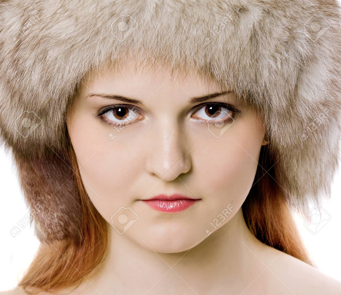 Close Up Portrait Of Young Beautiful Girl In Fur Hat Over