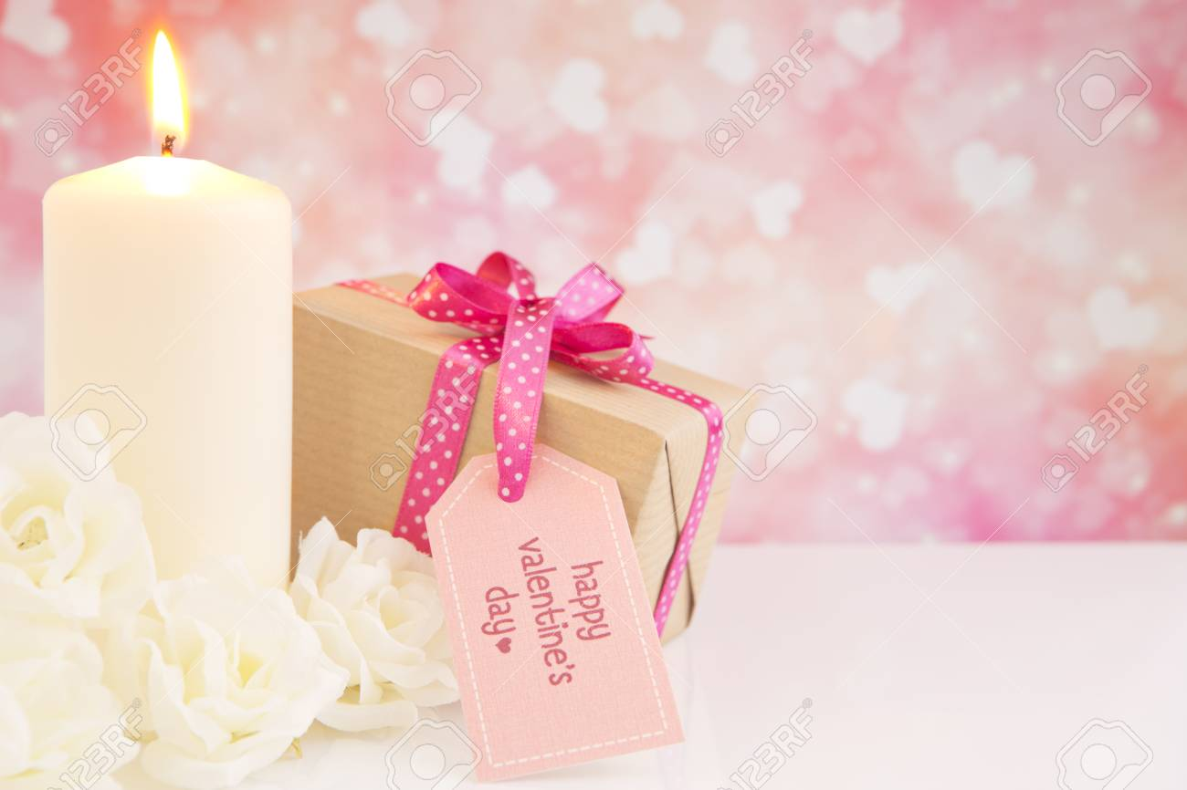 Valentine\'s Candle, Gift And Roses With A Bright Glittering ...