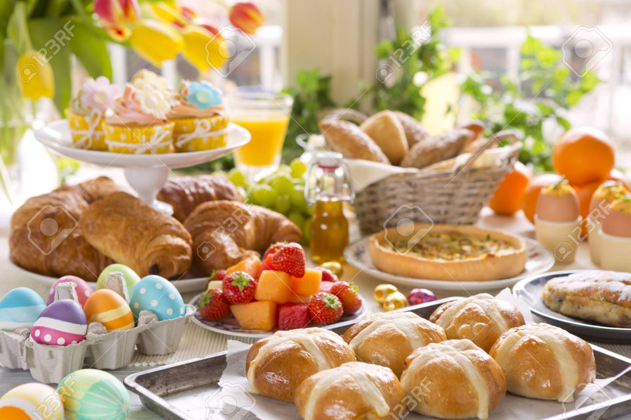Breakfast or brunch table filled with all sorts of delicious delicatessen ready for an Easter meal. - 94693740