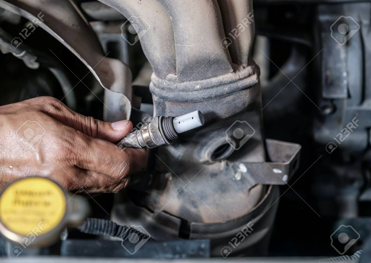 Check And Replace Oxygen Sensor By Car Technician Stock Photo Sensors How To Diagnose 110597173