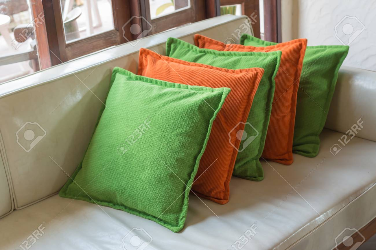 Astounding Orange And Green Decorative Pillows On White Leather Sofa Machost Co Dining Chair Design Ideas Machostcouk
