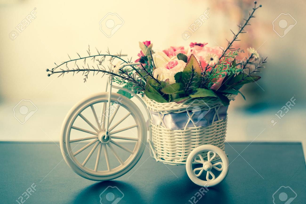 Artificial flowers in a white bicycle basket on black table stock artificial flowers in a white bicycle basket on black table vintage style stock photo mightylinksfo
