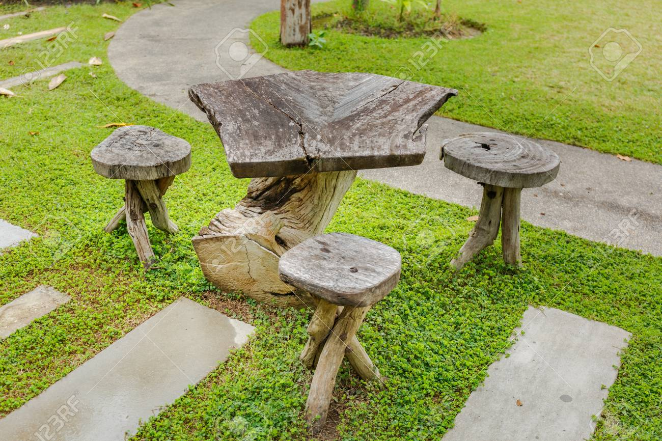 Old wooden table in topical garden