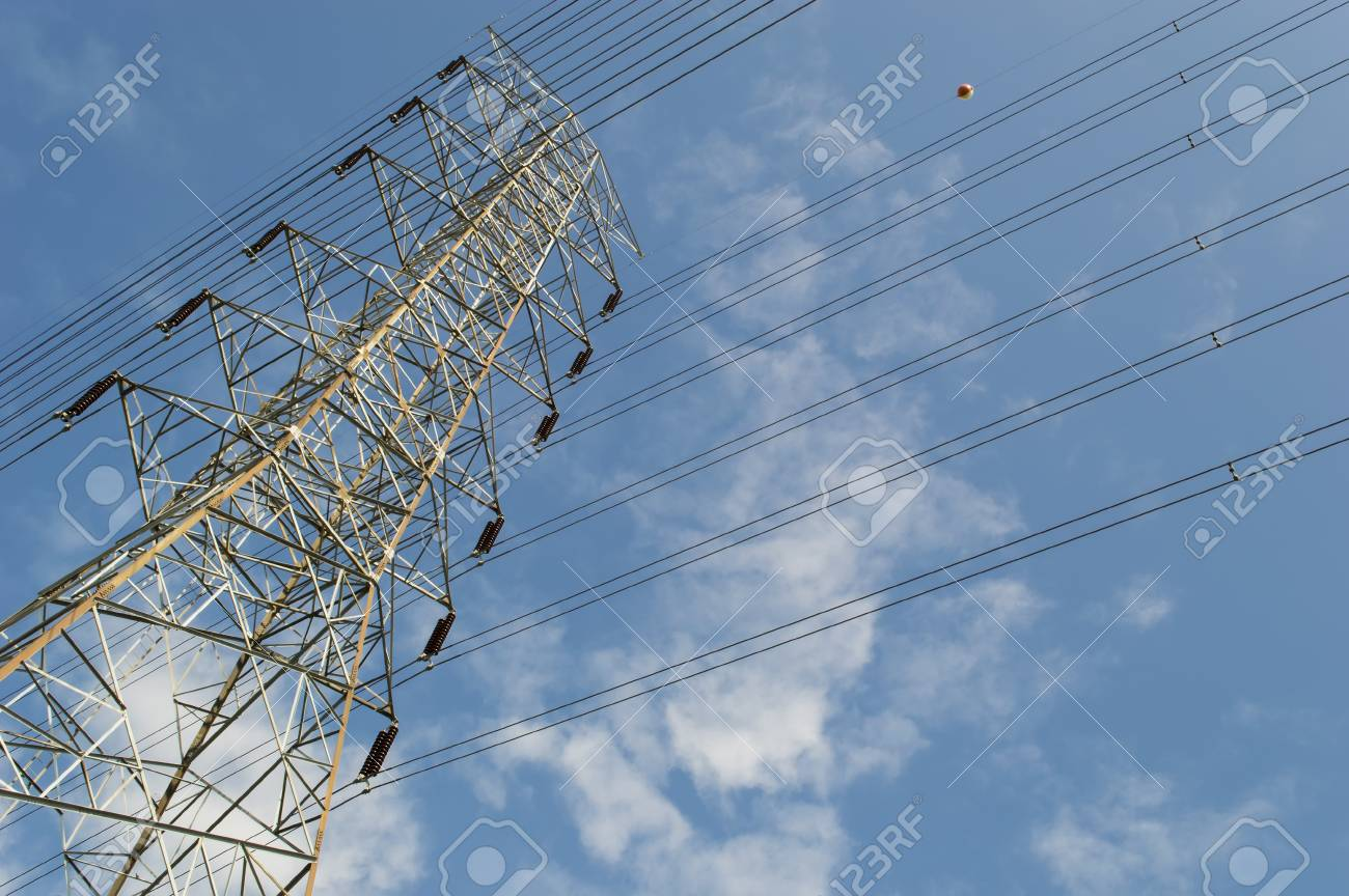 High voltage pole  and Power lines against the sky Stock Photo - 21212647