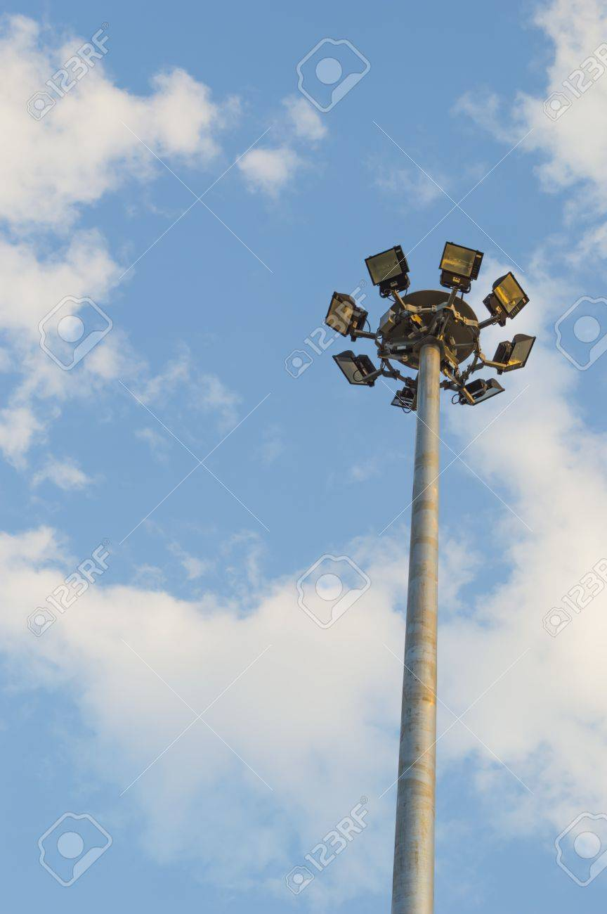 Stadium halogen Spot-light tower with  blue sky and cloud background Stock Photo - 21685382