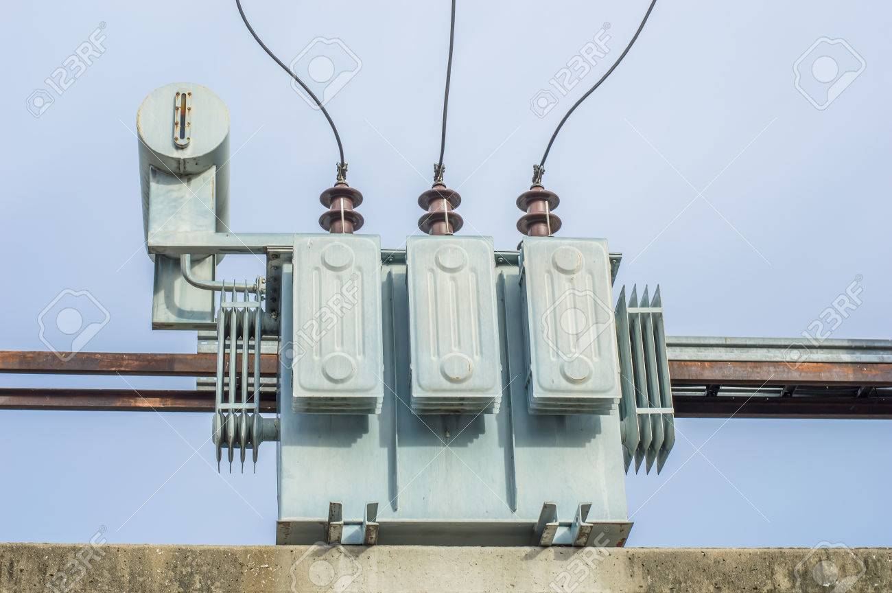 Transformer on Electricity post, high power station. High voltage with blue sky Stock Photo - 22270795