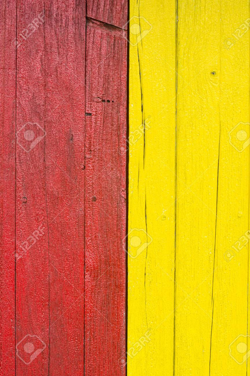 Plank Wall Painted With Red, Yellow Color Paint Stock Photo, Picture ...