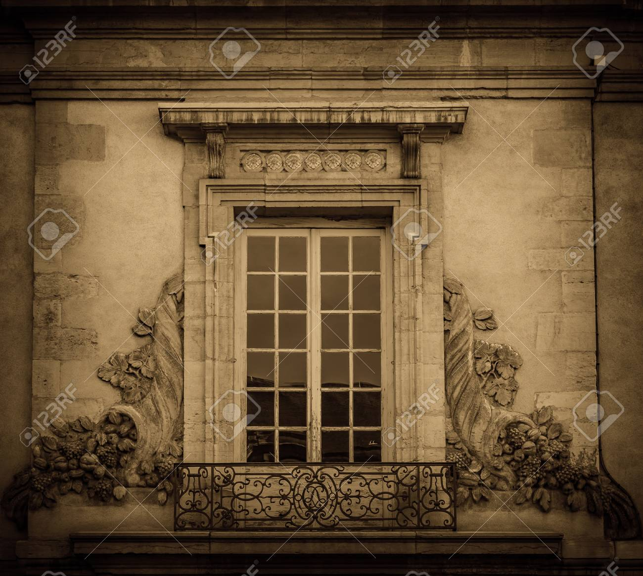 Big Old Window And Decoration On The Facade. City Of Dijon