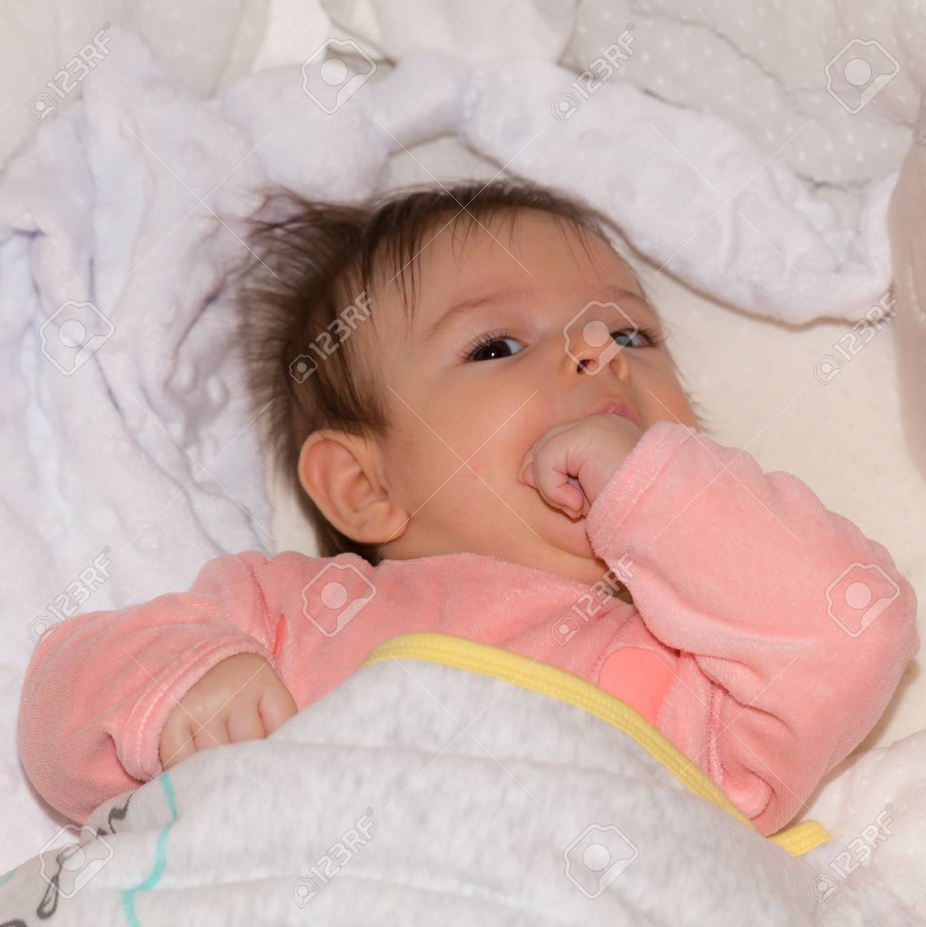 Sleepy Cute Baby Girl In The Crib Ready For Sleeping Stock Photo Picture And Royalty Free Image Image 93620077