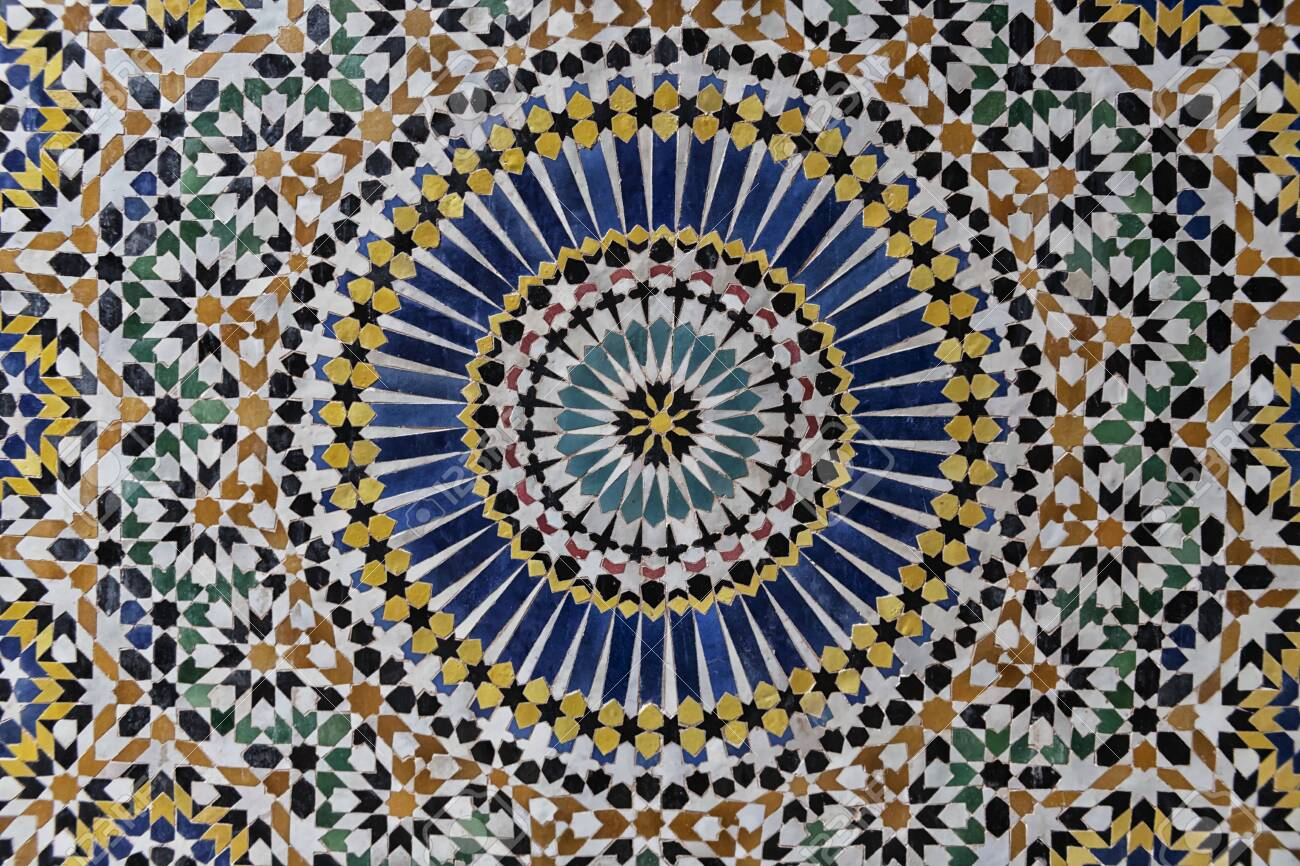 Colorful 24-fold star pattern in traditional islamic geometric design from the interior of Kasbah Telouet, Morocco. - 137682840