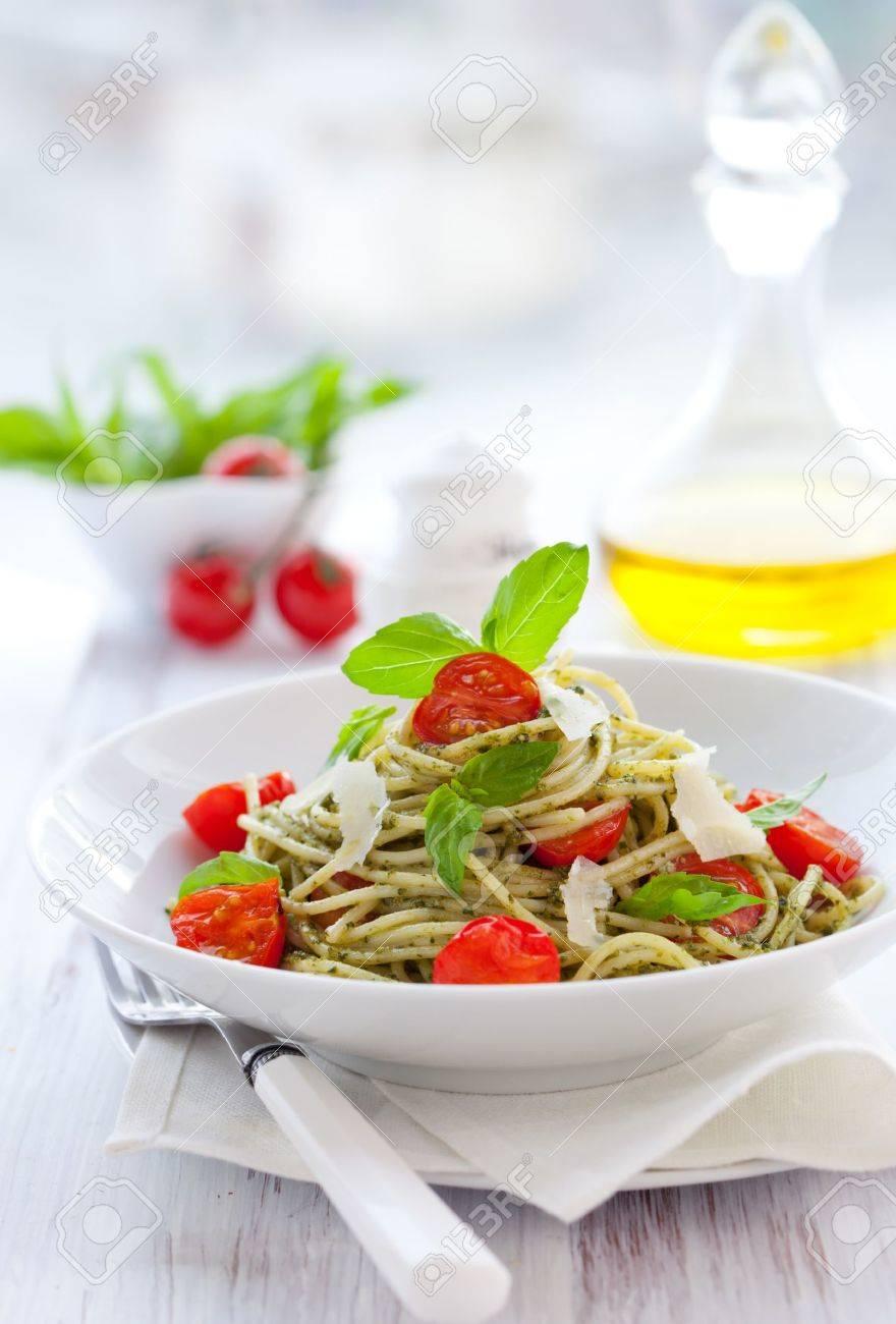 spaghetti with  pesto sauce,cherry tomato and cheese Stock Photo - 8602449