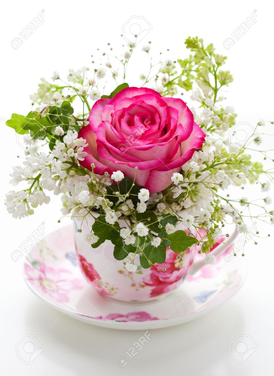 Pink rose and white lilac in a cup Stock Photo - 9118728