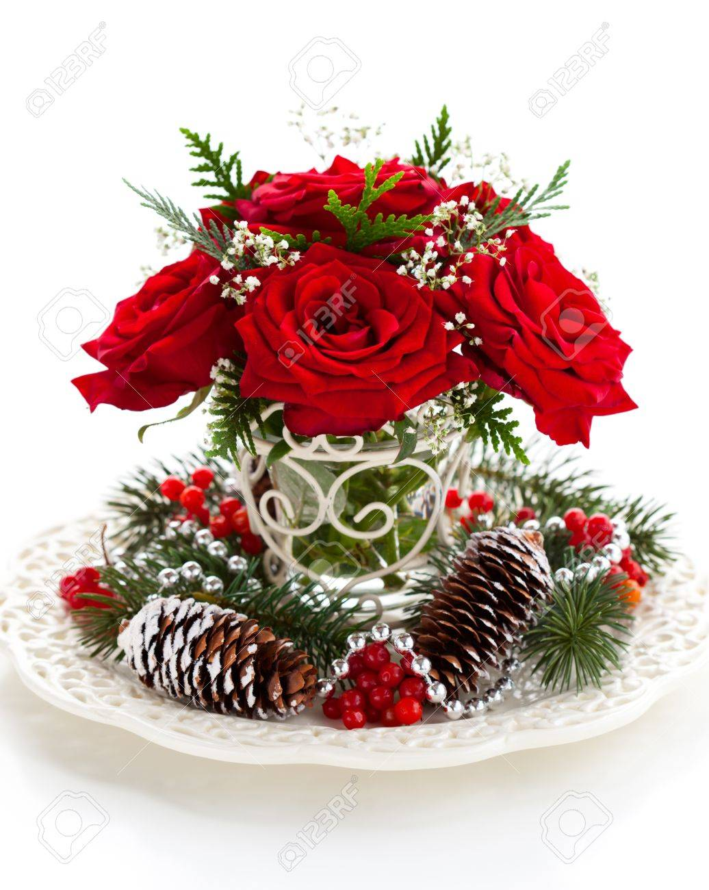 Christmas arrangement of red roses,fir, holly and pine cones Stock Photo - 10539051
