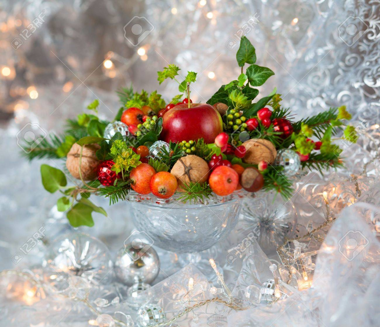 Christmas table decoration with fruit, nuts, fir branches Stock Photo - 15572550