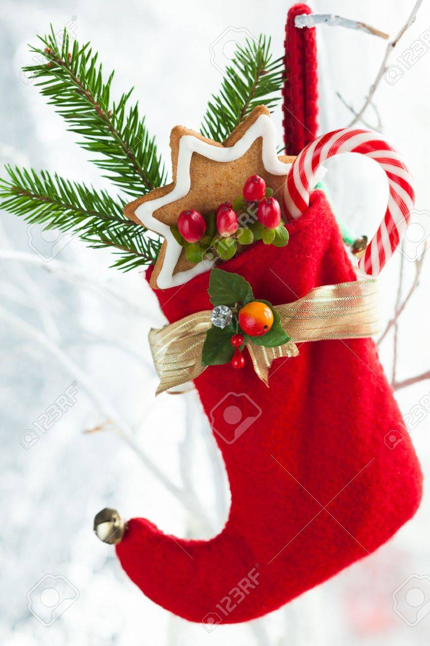 Christmas stocking with gifts,sweets and cookies Stock Photo - 15733113