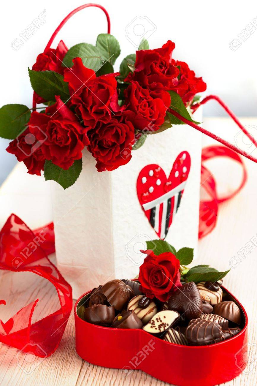 Red Roses And Chocolate Candies For Valentine Stock Photo Picture