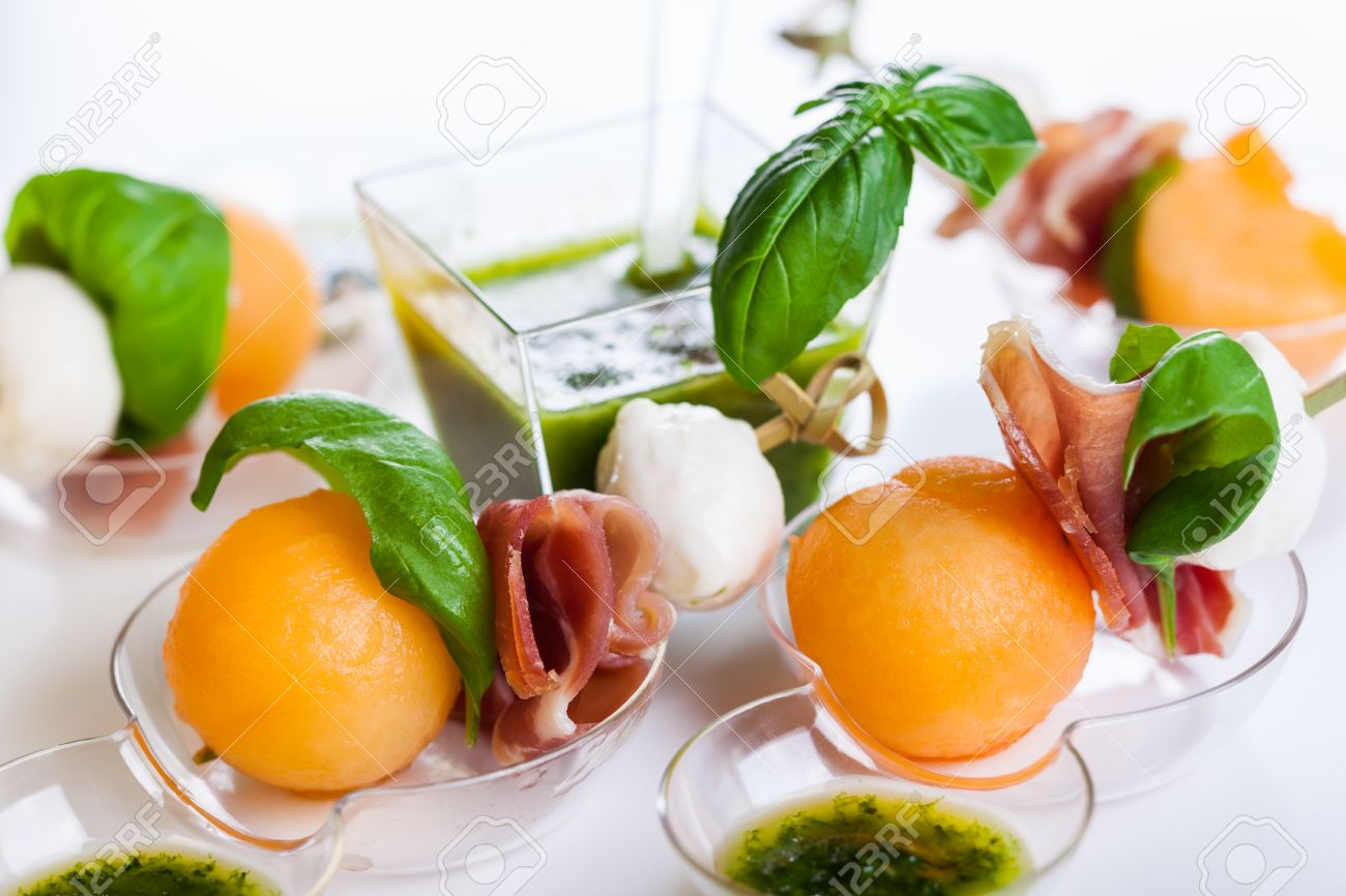 Appetizer With Melon,mozzarella And Prosciutto On Skewers Stock