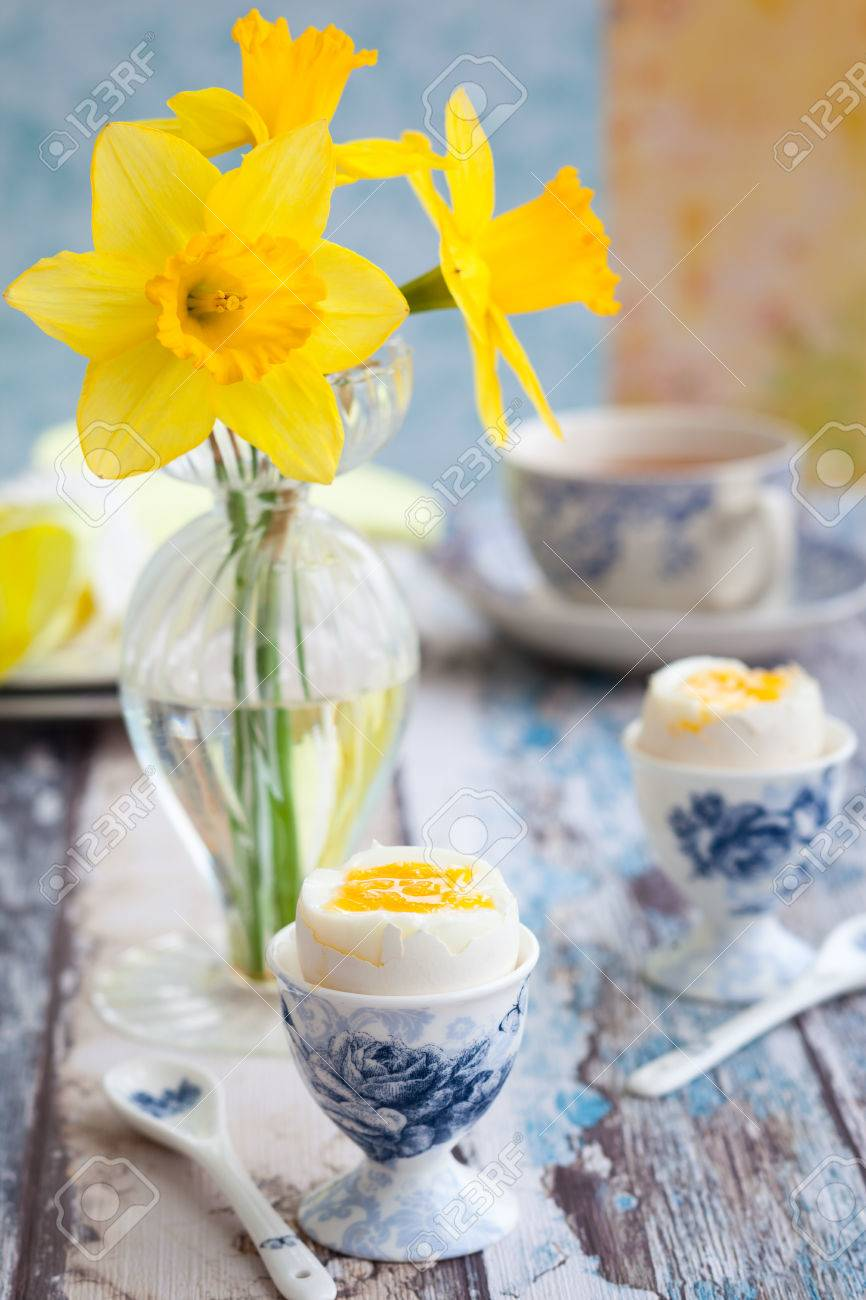 Breakfast Table Setting With Tea, Boiled Eggs And Spring Flowers ...