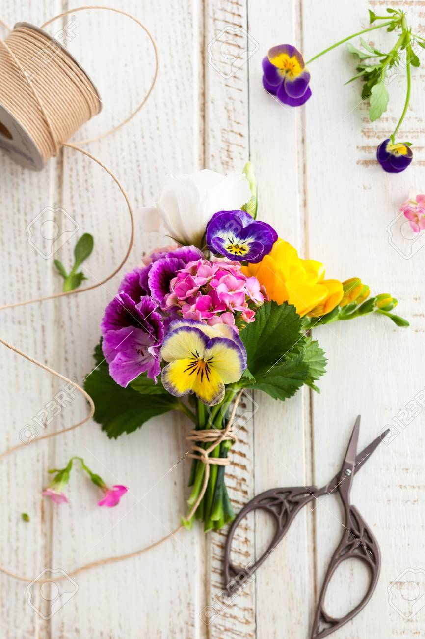 Beautiful Bunch Of Flowers On The Wooden Table Stock Photo Picture