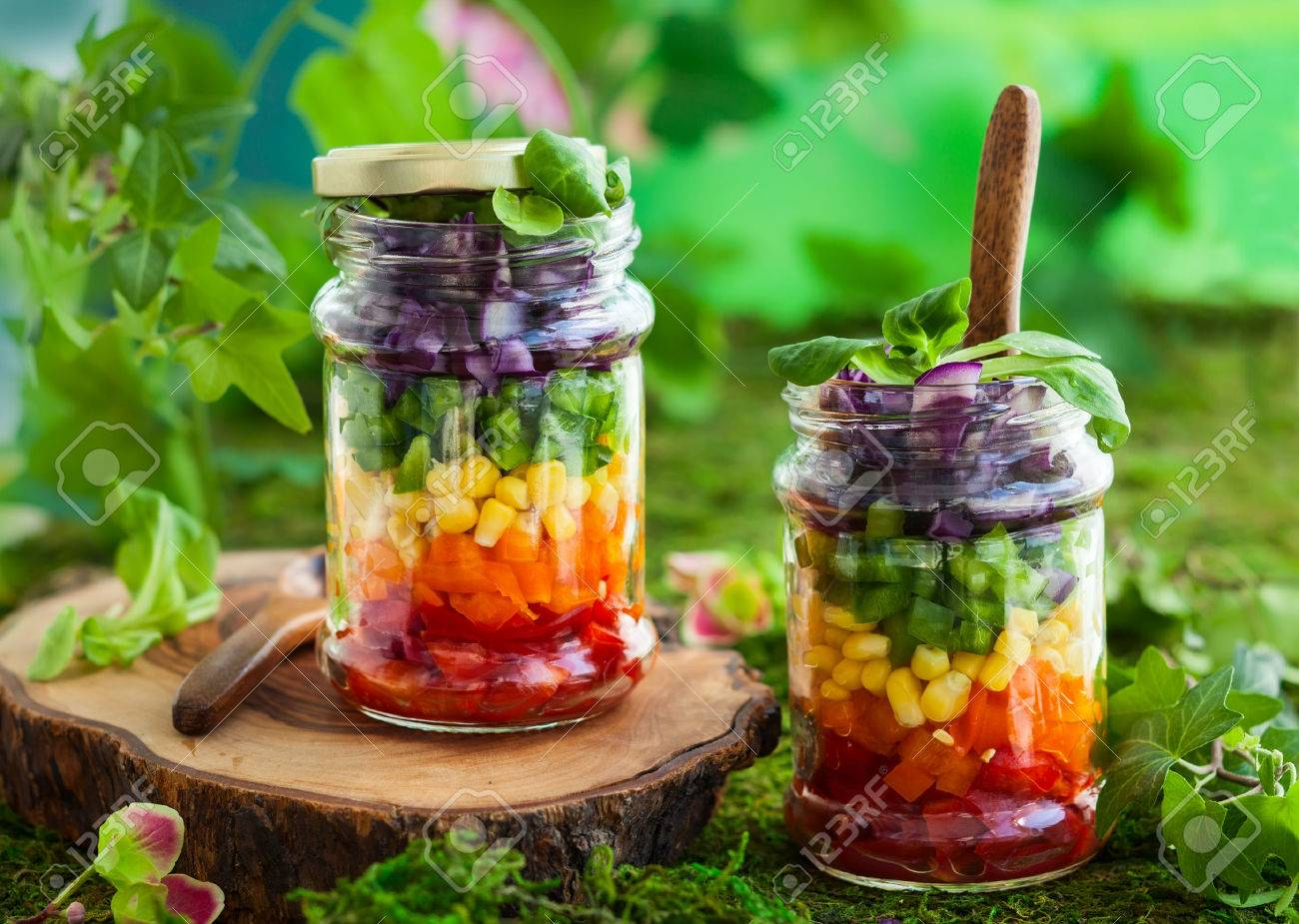 Vegetarian Rainbow Salad In A Glass Jar For Summer Picnic Stock
