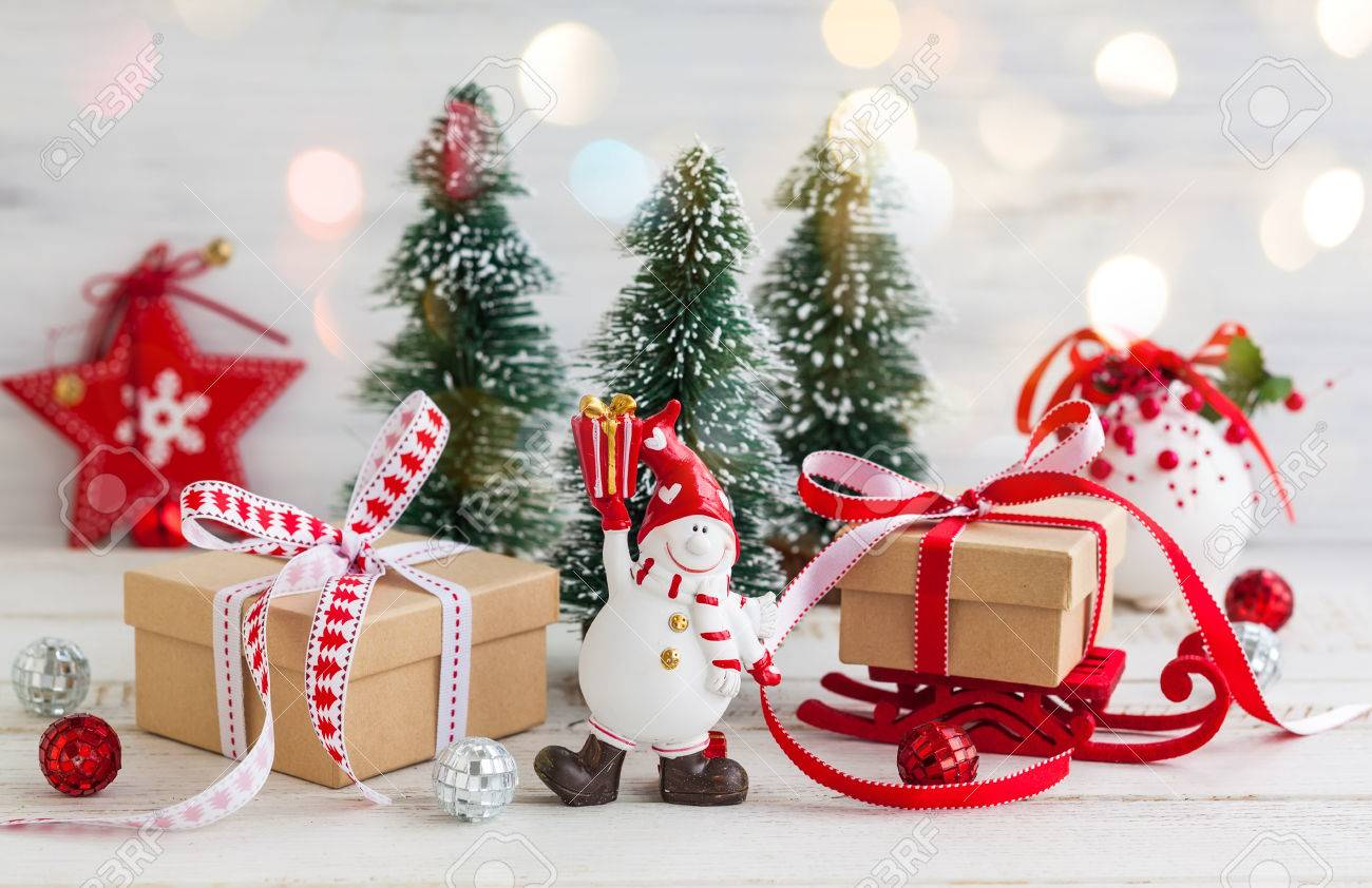 Snowman Gift Boxes And Decorative Christmas Trees On The White