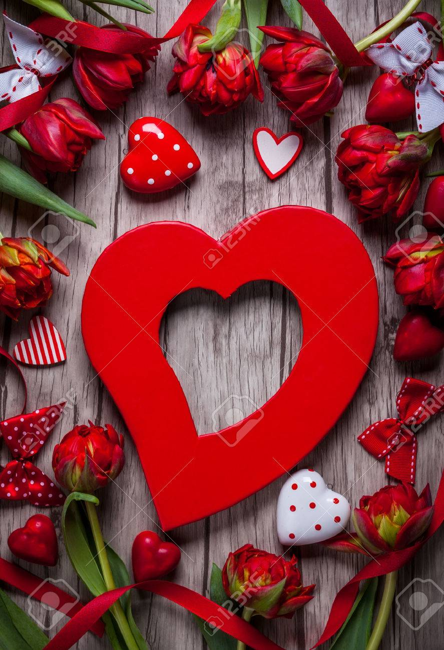 Valentines Day Background With Chocolates Hearts And Red Tulips